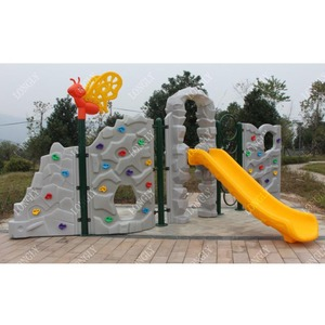 Children's rock climbing wall with plastic slide